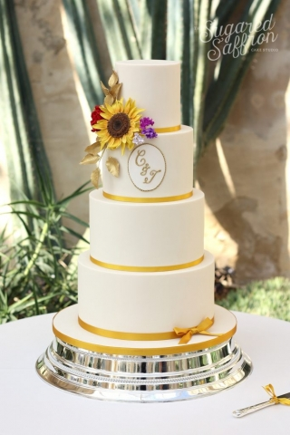 ivory cake with monogram and sugar sunflower at syon house