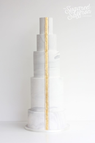 Tall marble wedding cake with centre gold stripe