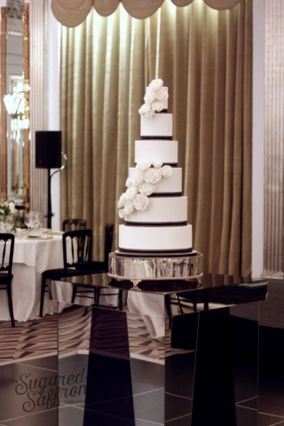 white wedding cake with black ribbon and sugar roses at claridges