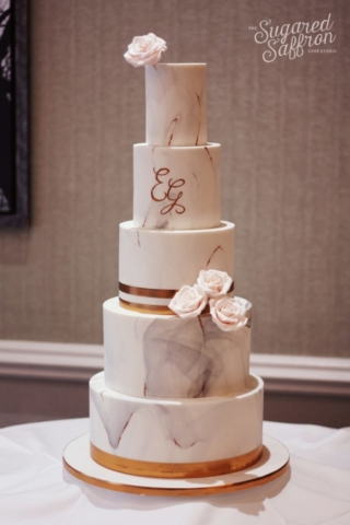 Grey marble with copper stripes. EG copper monogram and pink roses