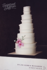 White wedding cake with straight ruffles. Straight lines and sugar african orchids.