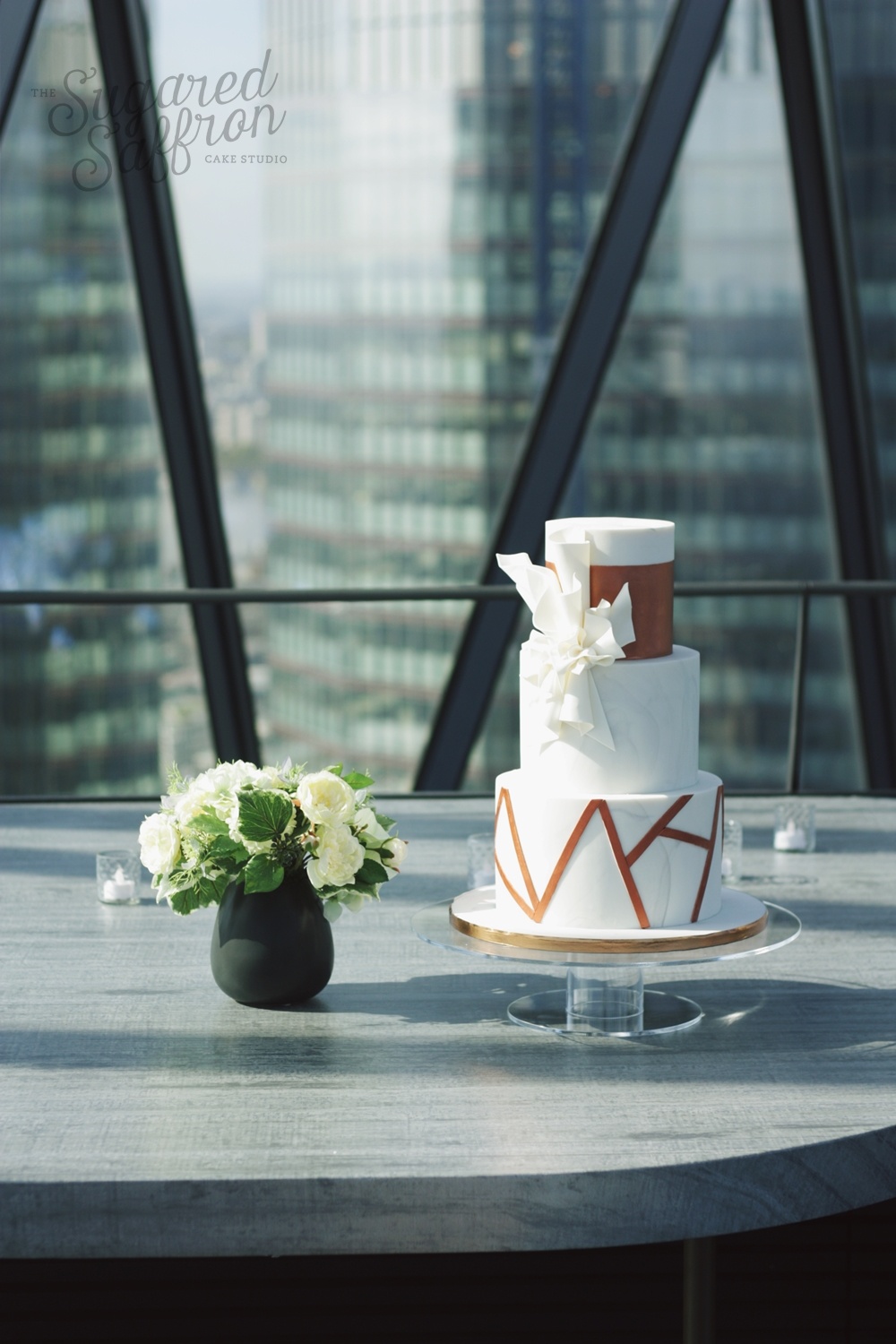 Modern bronze wedding cake at the gherkin in london