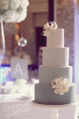 Ombre grey wedding cake in different shades.