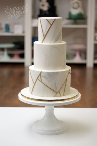 Smoky grey marble wedding cake with gold geometrical lines
