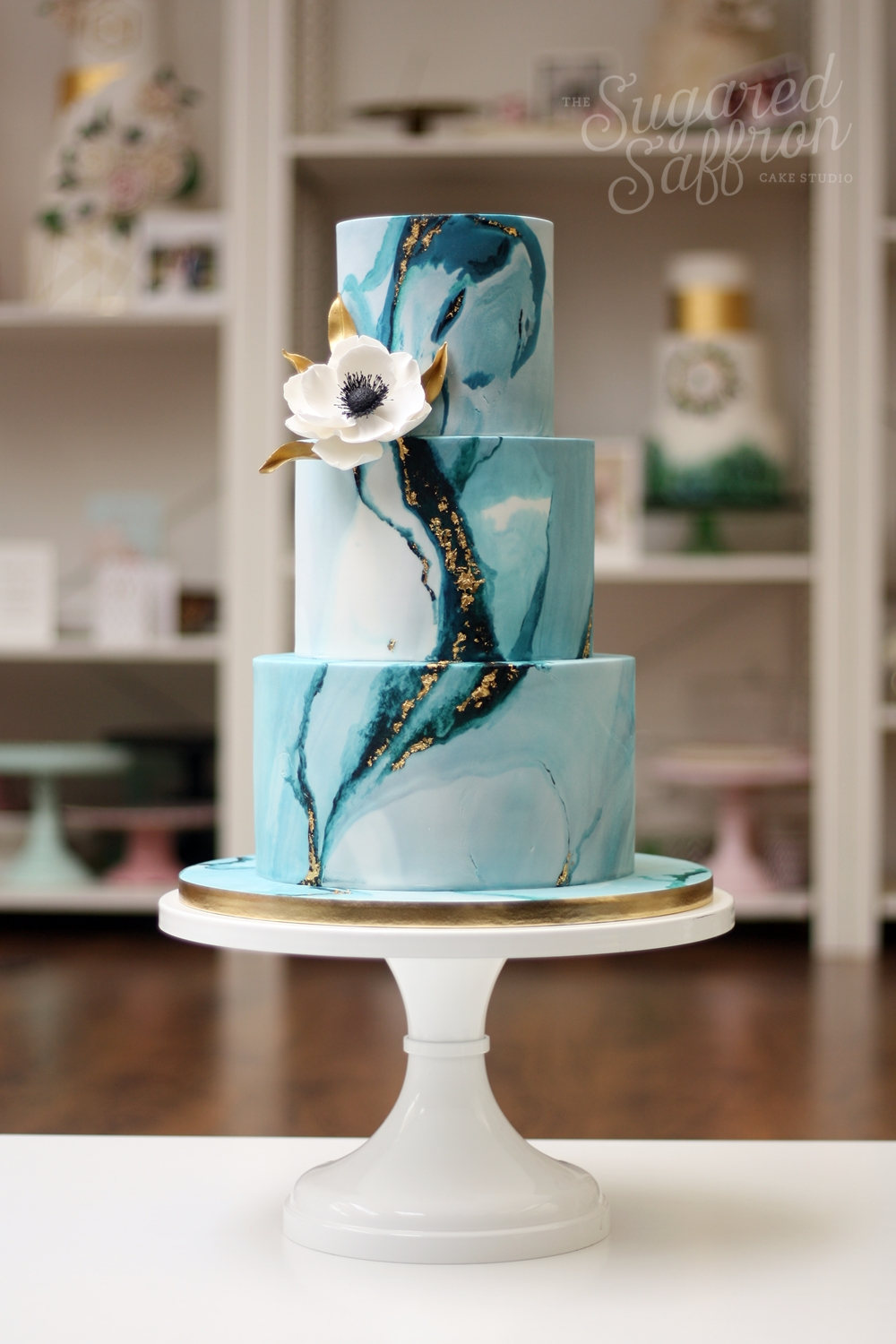 Blue and teal marble wedding cake with white anemone in London