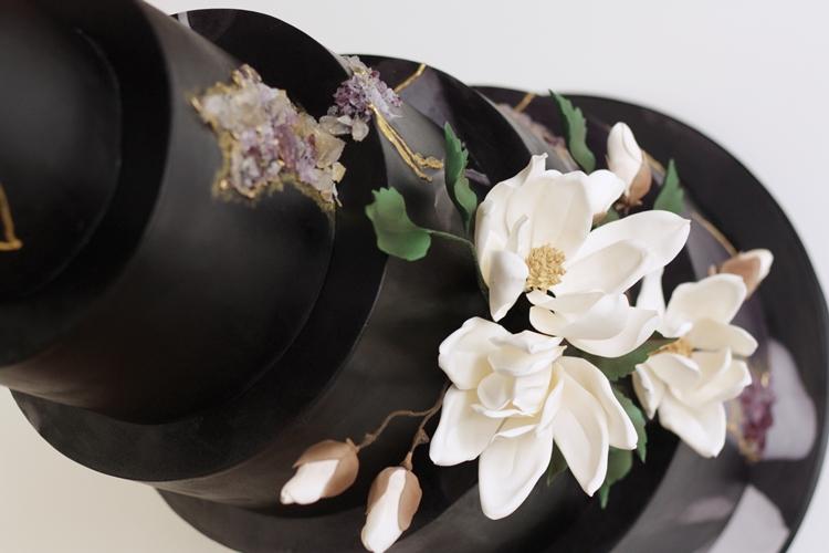 Bespoke black wedding cake by sugared saffron in london