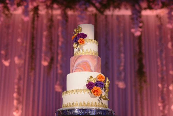 Luxury wedding cake in gold orange purple at one marylebone