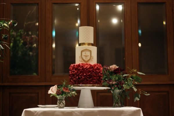 Ivory and gold leaf wedding cake at the ned. Dark red ombre ruffles on bottom tier