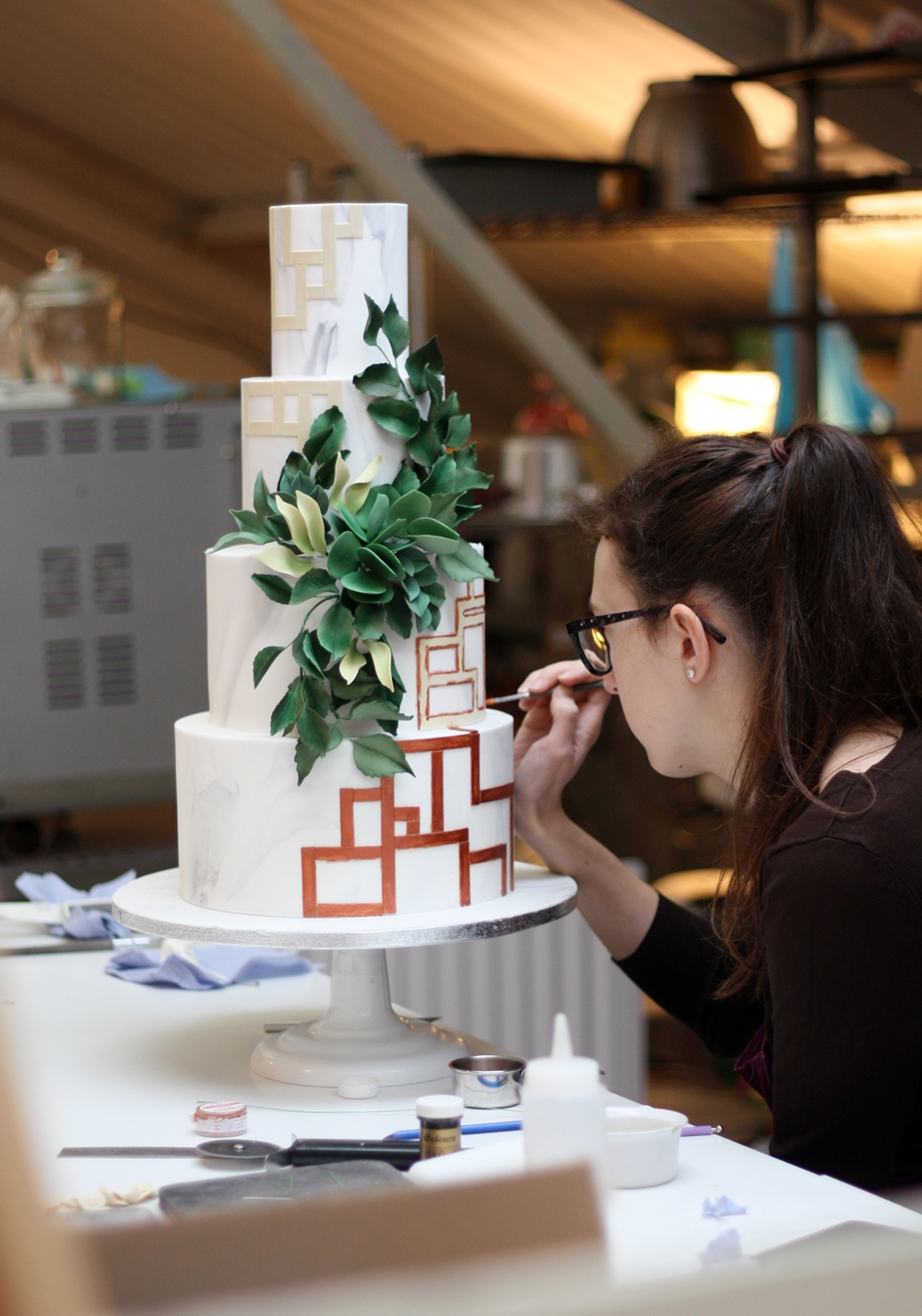 Cake designer working on wedding cakes