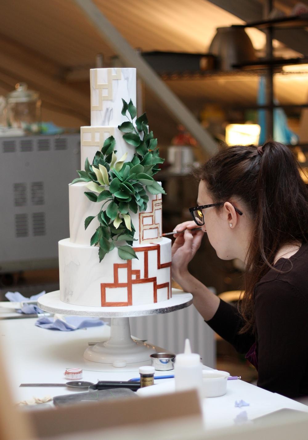 Cake designer working on wedding cakes