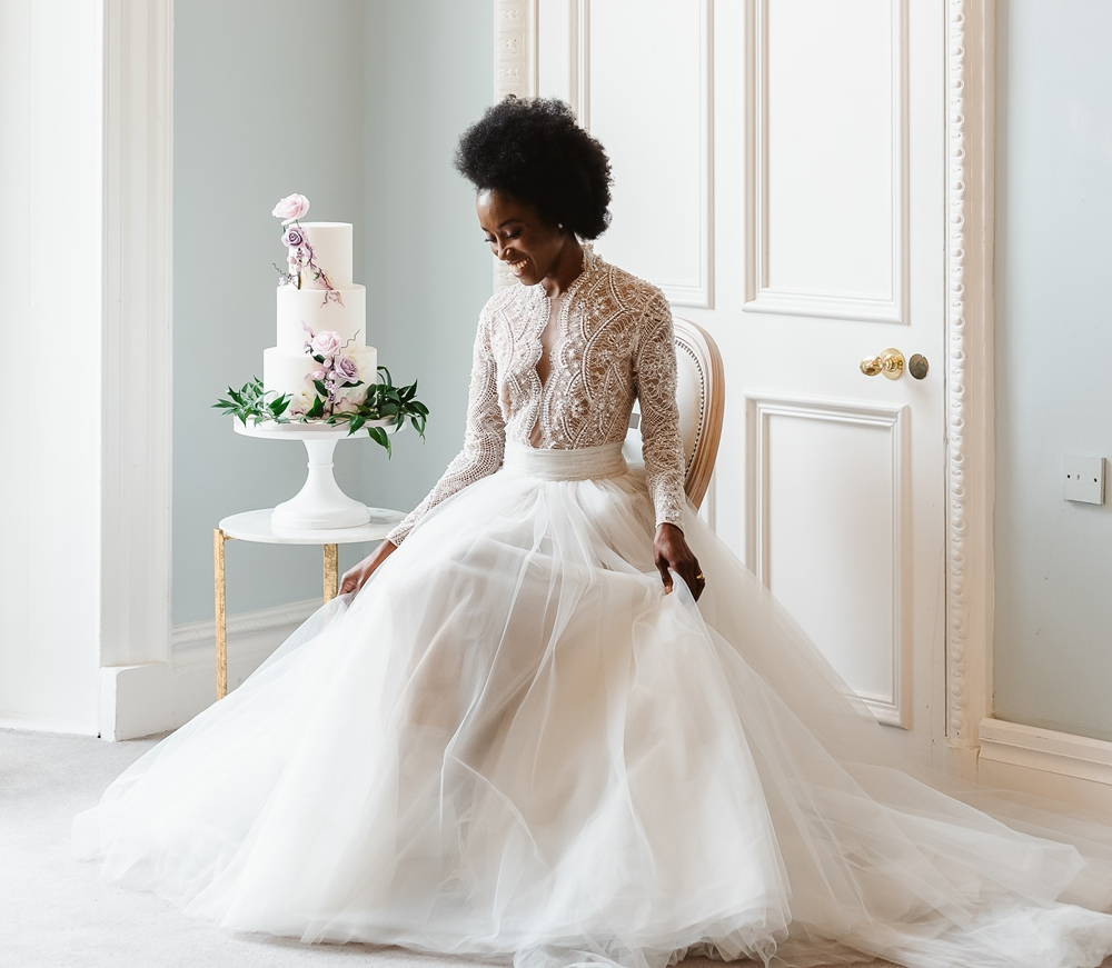 Beautiful black bride with luxury wedding cake at carlton house terrace