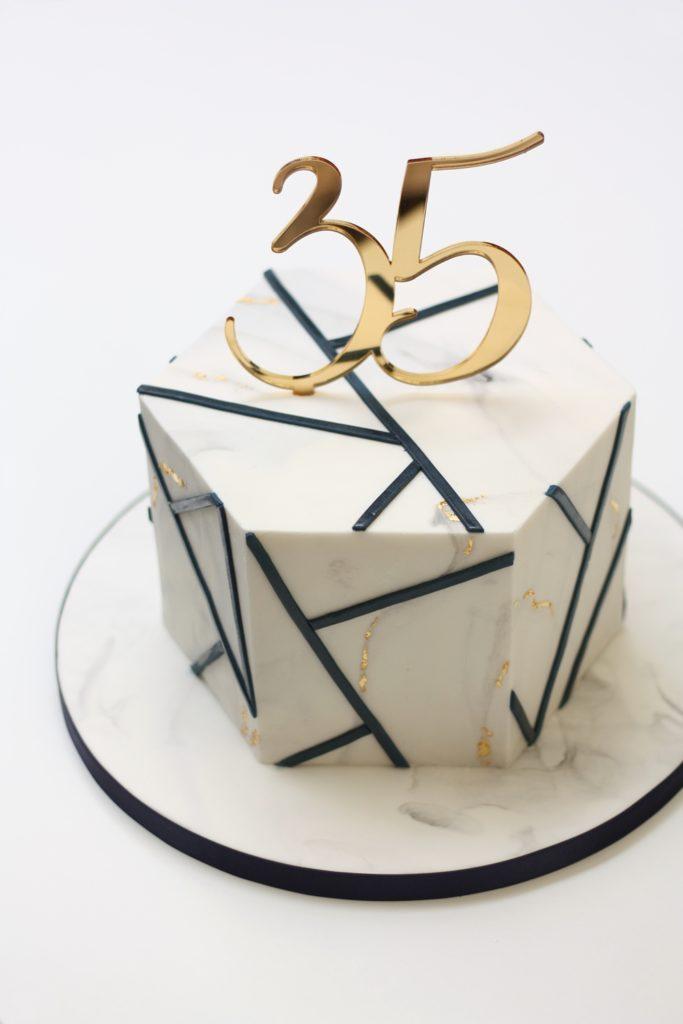 navy and marble birthday cake